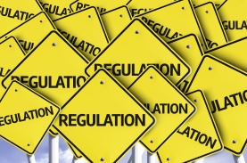 Regulation written on multiple road sign